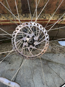 Picture of a very dirty bicycle rotor